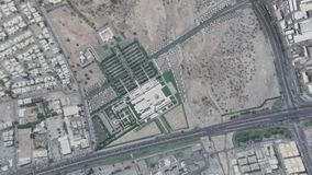 Earth Zoom In Zoom Out Sultan Qaboos Muscat Oman. Sultan Qaboos Muscat Oman seen from space to street level. It can easily be used for tourism marketing videos stock video footage