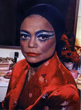 Eartha Kitt. American actress, singer, cabaret star, and civil/human rights activist Eartha Kitt strikes a pose in stage make-up and colorful robe at the Kennedy Stock Image
