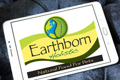 Earthborn Holistic pet food logo. Logo of Earthborn Holistic pet food company on samsung tablet Stock Photography