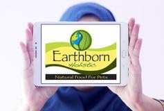 Earthborn Holistic pet food logo. Logo of Earthborn Holistic pet food company on samsung tablet holded by arab muslim woman Royalty Free Stock Photo
