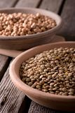 Earthen bowls with lentils and chickpeas Royalty Free Stock Image