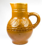 Earthen jar. Closeup of a yellow decorative earthen jar, isolated on a white background royalty free stock photography