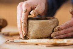 Earthen jar making by hands of woman potter in workshop Royalty Free Stock Photo