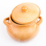 Earthen pot with lid tilted on a white background. Cute earthen pot with lid tilted on a white background Stock Photo