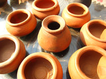 Earthen pots. Close up of small brown earthen pots for drying under sun in indian village Royalty Free Stock Image
