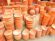 Earthen pots piled up for sale Stock Image