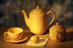 Earthenware. Coffee-pot, cup, sugar-bowl and lemon.  Still life Stock Photography