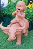 Earthenware of boy sit on the buffalo back and play flute Royalty Free Stock Photography