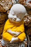 Earthenware of child monk Stock Photos