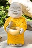 Earthenware of child monk Stock Photo