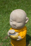 Earthenware of child monk. In temple Stock Image