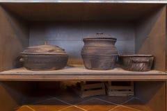Earthenware cooking on shelf Royalty Free Stock Image
