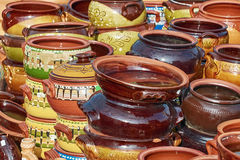 Earthenware Crockery. A Lot of Earthenware Crockery on the Pottery Market Royalty Free Stock Photography