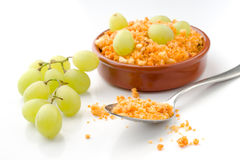 Earthenware with crumbs with fresh grapes rural Spanish stew Stock Photo