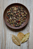 Earthenware dish with spices and bay leaf Royalty Free Stock Photos