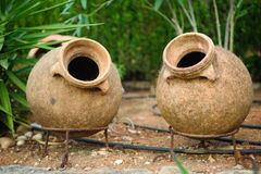 Earthenware jar in garden Royalty Free Stock Photos