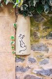 Earthenware nameplate with a cat figure attached to the frontage. Of a house in the village Saint Montan in the Ardeche region of France Stock Photos