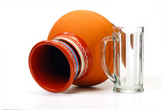 Earthenware pot and empty glass isolated Royalty Free Stock Photography
