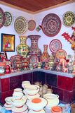 Earthenware on the shelves of shop. Ceramic goods. Products of ceramics on sale Stock Photo
