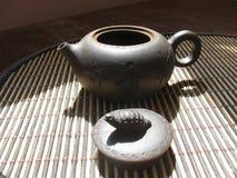Earthenware teapot stock photo