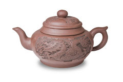Earthenware teapot  on white background Royalty Free Stock Photo
