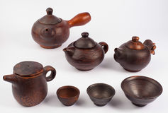 Earthenware teapots and bowls Royalty Free Stock Photos