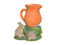Earthenware vase with rabbit plaster. Royalty Free Stock Photography