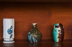 Earthenware on wooden shelf Royalty Free Stock Image