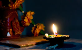 Earthernware lamp lit on Diwali. Handmade Earthenware lamps are traditionally made and decorated so they can be lit on Diwali night Royalty Free Stock Photos
