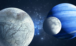 An Earthlike moon and icy moon orbiting a gas giant host planet Stock Photography