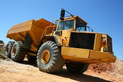 Earthmover. Heavy earthmover construction truck against a blue sky royalty free stock photo