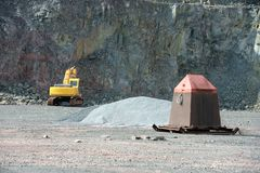 Earthmover in an active quarry mine of porphyry rocks. digging. Earthmover in an active quarry mine of porphyry rocks. digging Stock Photography