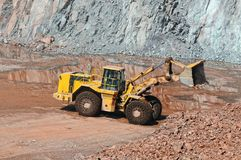 Earthmover in an active quarry mine of porphyry rocks. digging. Earthmover in an active quarry mine of porphyry rocks. digging Stock Photos