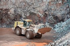 Earthmover in an active quarry mine of porphyry rocks. digging. Earthmover in an active quarry mine of porphyry rocks. digging Royalty Free Stock Image