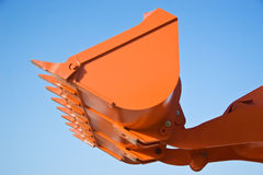 Earthmover Bucket. Bucket of an earthmover raised up in the air Royalty Free Stock Image