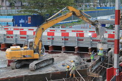 Earthmover in construction place. Earthmover operation in construction place Stock Photos