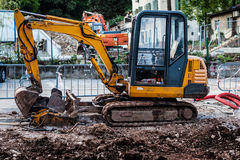 Earthmover. A dirty and grunge earth mover in a construction site Stock Image