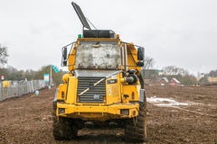 Earthmover dumper on site. Yellow volvo stone cat tipper caterpillar quarry cava rubble earthmover dumper on site Royalty Free Stock Photography