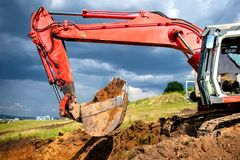 Earthmover, industrial digger and excavator working in sandpit. On construction site Royalty Free Stock Images
