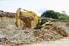 Earthmover in limestone quarry. Germany, sedimental rock Royalty Free Stock Photo