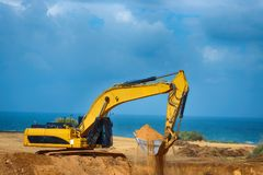Earthmover is preparing to load a truck. On the  building site Royalty Free Stock Photography