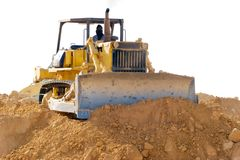 Earthmover on site. A man with covered nose and mouth operating an earthmover Royalty Free Stock Images