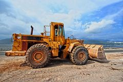 Earthmover working on construction site Stock Photography