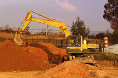 Earthmoving Equipment. Yellow caterpillar digging royalty free stock photography