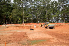 Earthmoving Equipment on Graded Residential Lots. Heavy equipment in graded new residential construction site royalty free stock photos