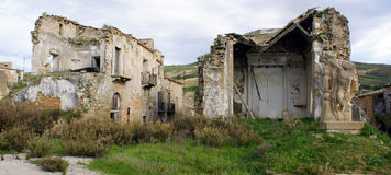 Earthquake damaged buildings. Ruined buildings in the town square at Poggioreale, Sicily, which was destroyed in the Belice Valley earthquake in 1968 stock photo