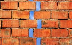 Earthquake. Red broken wall at earthquake Stock Photo