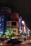 After Earthquake and Tsunami in Japan. Saving Electricity of the Stores in Shinjuku Stock Photos