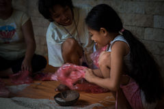 Earthquake victim helps prepare food aid Royalty Free Stock Photography