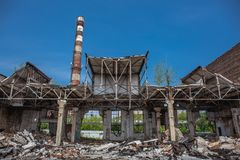 Earthquake or war aftermath or hurricane or other natural disaster, broken ruined abandoned industrial buildings royalty free stock photography